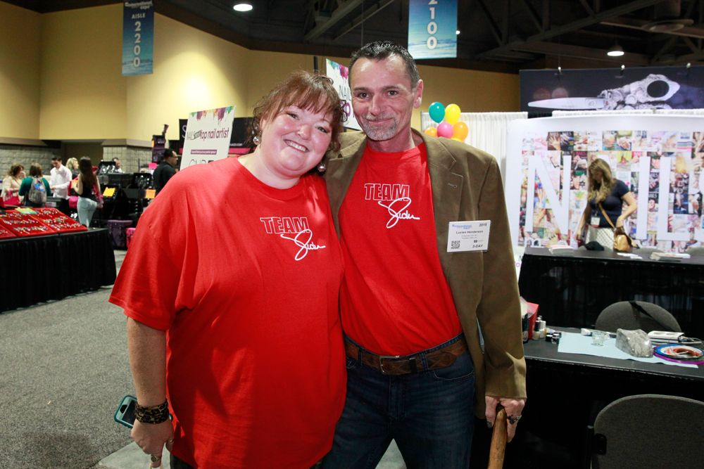 "<p>The&nbsp;<a href=""http://instagram.com/fingernailfixer"">@fingernailfixer</a> Holly Schippers and Empower Nail Art's Lucien Henderson don ""Team Vicki"" shirts to honor the late <a href=""http://www.nailsmag.com/news/109566/vicki-peters-industry-icon-passes-away"">Vicki Peters</a>.</p>"