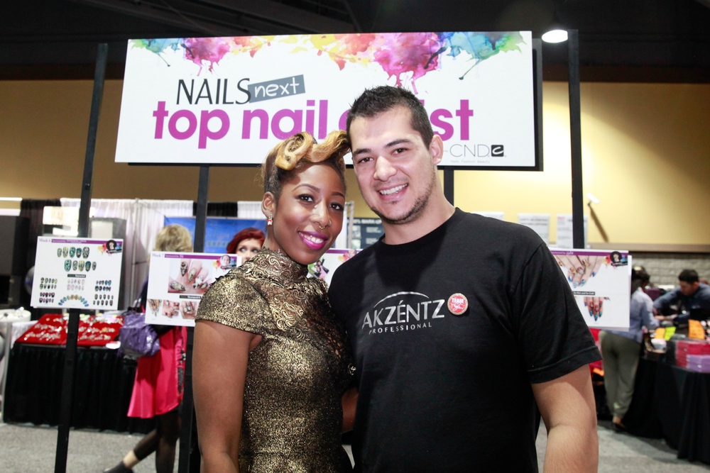 <p>This year's NAILS Next Top Nail Artist winner Lavette Cephus with last year's Next Top Nail Artist competitor Chris Mans</p>
