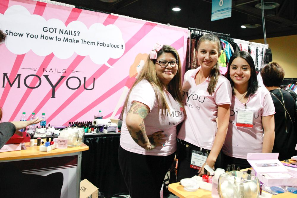 <p>MoYou's nail art divas Adiranna, Anna, and Favi demoed the company's stamp products at their booth.</p>