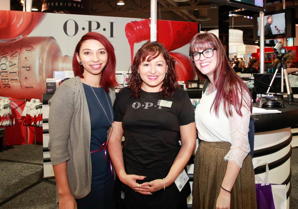 <p>NAILS' Taylor Yates and Kelsey Nolan (right) with OPI's Adela Mu&ntilde;oz (center)</p>