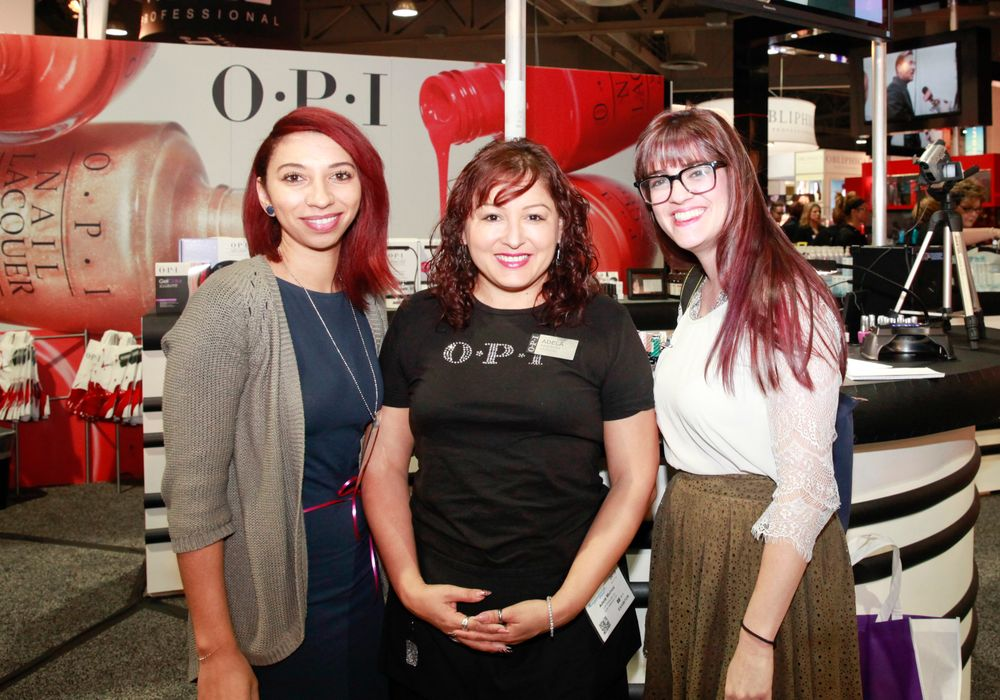 <p>NAILS' Taylor Yates and Kelsey Nolan (right) with OPI's Adela Mu&ntilde;oz (center)</p>