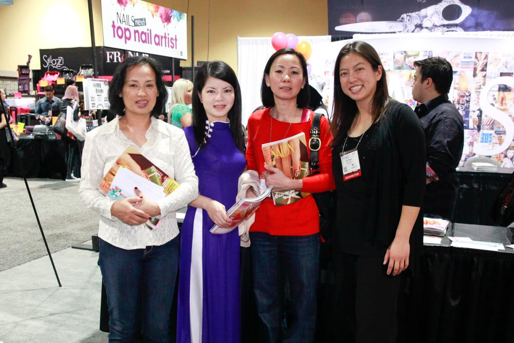 <p>Bliss on Broadway's Akiko Roan, Ivy Nguyen, and Kim Anh Vu met VietSALON associate editor Kim Pham at her booth.</p>