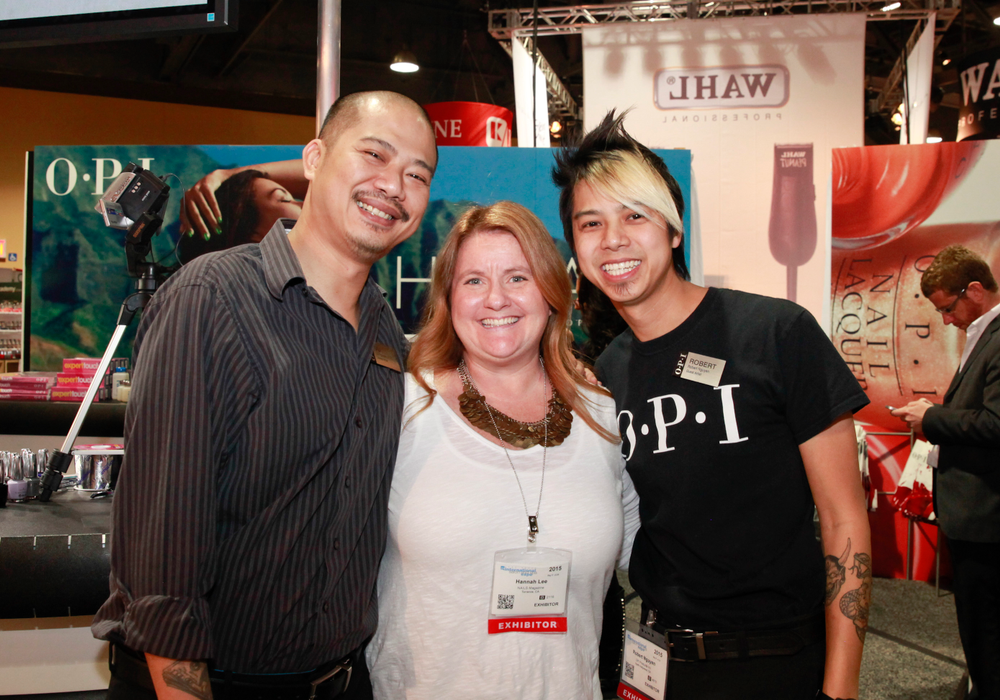 <p>The Nguyen brothers Vu (left) and Robert with Hannah (center)</p>
