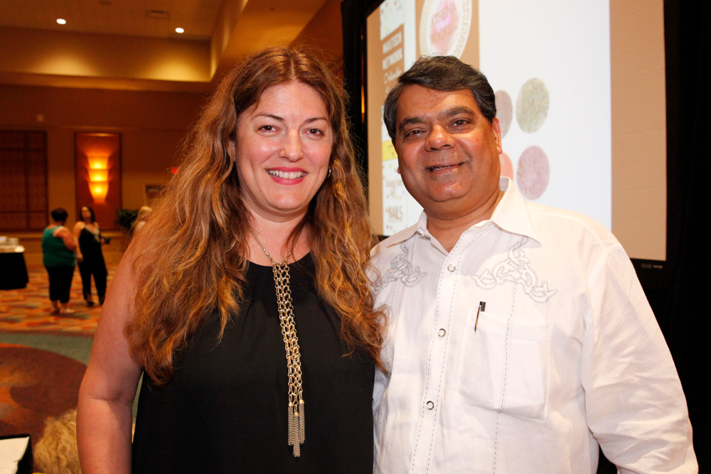 <p>NAILS publisher Michelle Mullen with American Dawn's Ron Kothari</p>