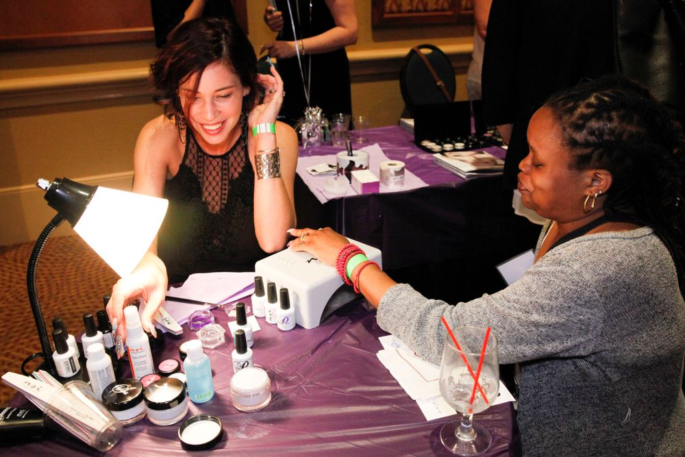 <p>NSI's Jana Warnke demos a nail art technique on Keisha Brown</p>