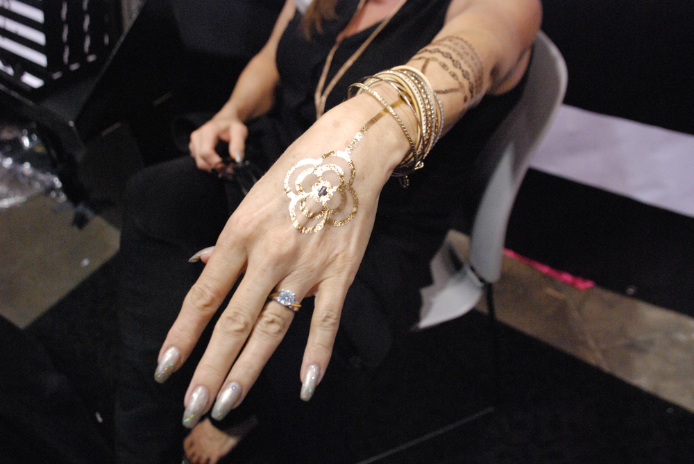 <p>OPI educator Shannon Rooney shows off her Lustria jewelry tats.</p>