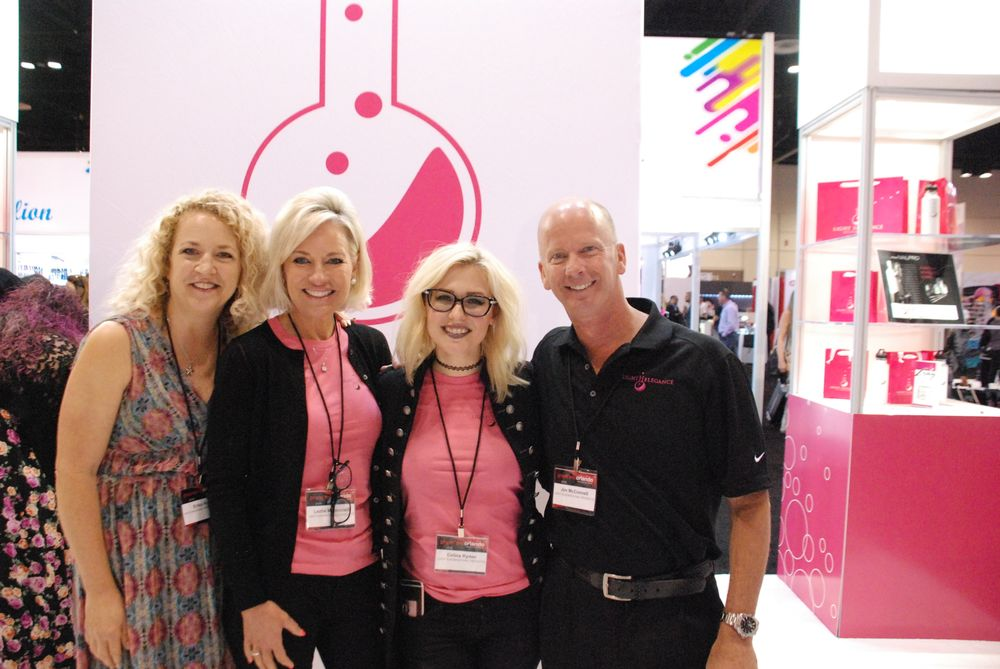 <p>NAILS editor Erika Kotite with Light Elegance's Leslie McConnell, Ruth Deruddere, Celina Ryden, and Jim McConnell</p>