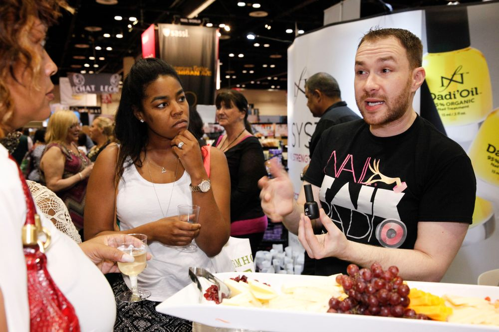 <p>Nail Talk Radio's Braden Jahr demonstrates how to use Famous Names' IBX during NTR's wine and cheese happy hour.</p>
