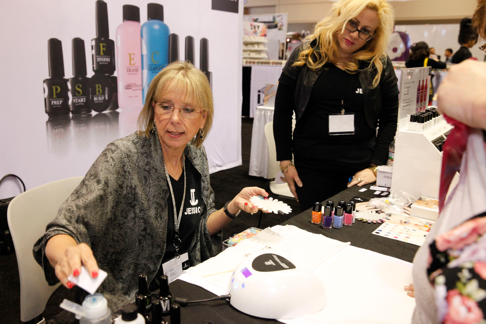 <p>Kris Ruffin demonstrates nail art using Jessica Geleration products.</p>