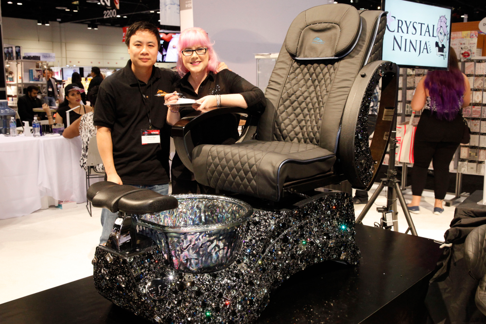 <p>Whale Spa's Johnny Ngo with the amazing artist who added sparkle to this pedicure spa chair.</p>