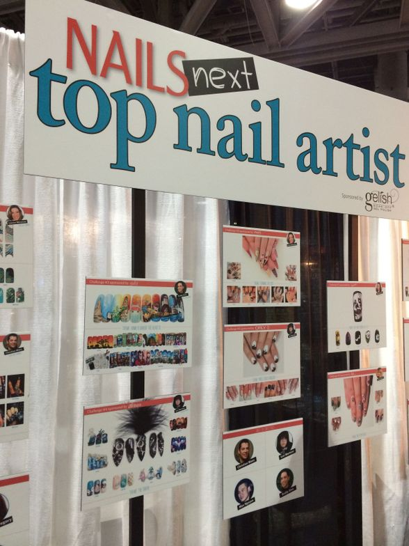 <p>NAILS Next Top Artist took over the NAILS Magazine booth. All 12 competitors and challenges were highlighted in the backdrop.</p>