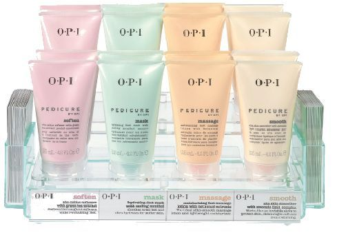 """<p>OPI&rsquo;s line of pedicure products caters to the foremost qualities of a pedicure: softening, hydrating, massaging, and smoothing. The system includes an AHA Callus Softener with Green Tea Extract (which can be used alone or with the OPI Scrub for exfoliation), a Hydrating Foot Mask with cooling menthol, a Moisturizing Foot Massage Lotion with botanical extracts, and an AHA Skin Smoother with Avocado Lipid Complex.</p> <p><a href=""""http://www.opi.com"""">www.opi.com</a></p>"""