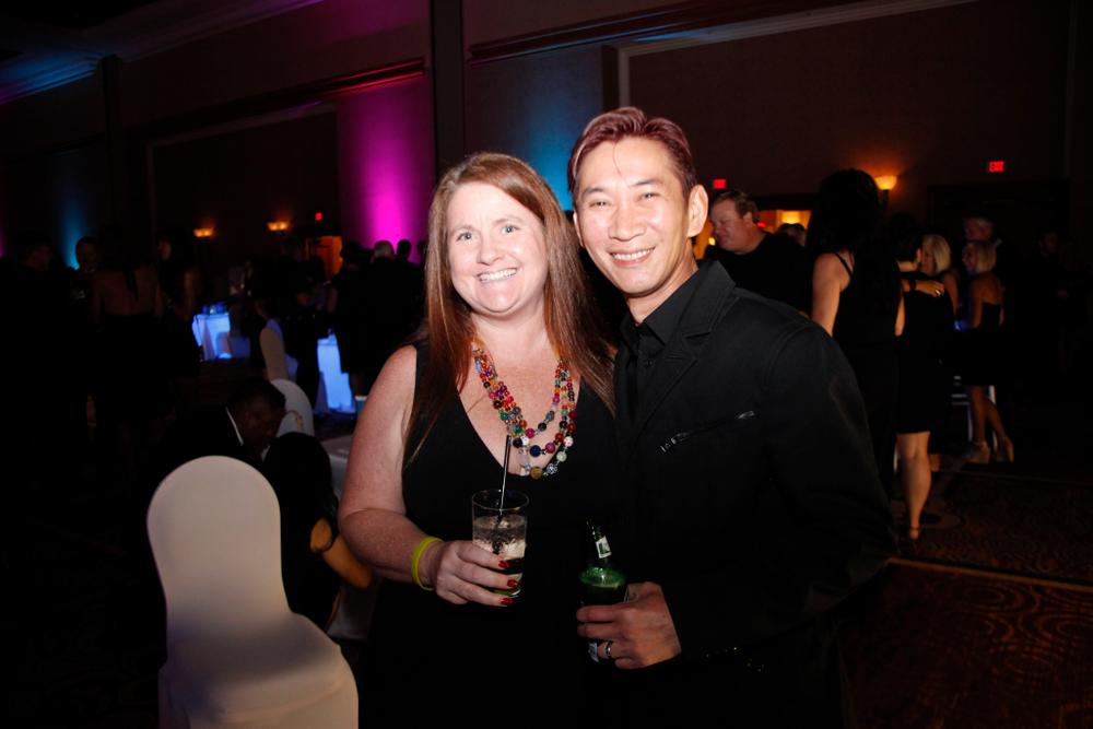<p>NAILS' Hannah Lee with OPI Educator Joseph Pham</p>
