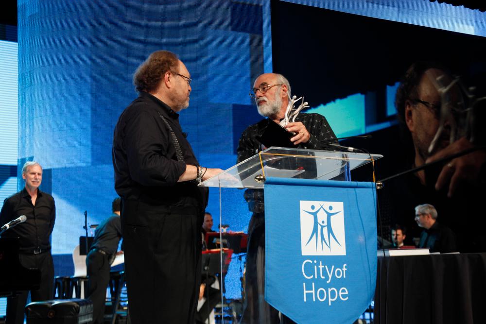 "<p>George Schaeffer receiving his Spirit of Life Award from City of Hope president Dr. Michael <span class=""st"">Friedman</span>.</p>"