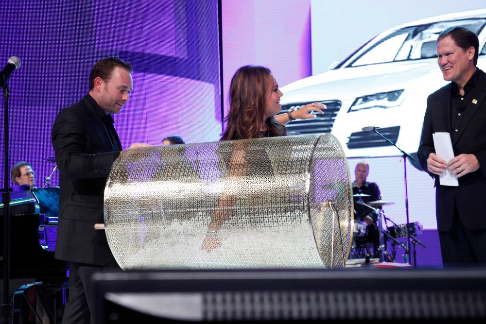 <p>George's kids Robbie and Nicole Schaeffer drew the prize-winning raffle for the Audi A7.</p>