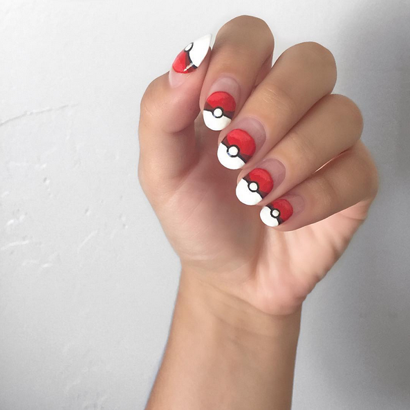 """<p>Pok&eacute; ball nails by <a href=""""https://www.instagram.com/nailsbyharlig/"""">@nailsbyharlig</a></p>"""