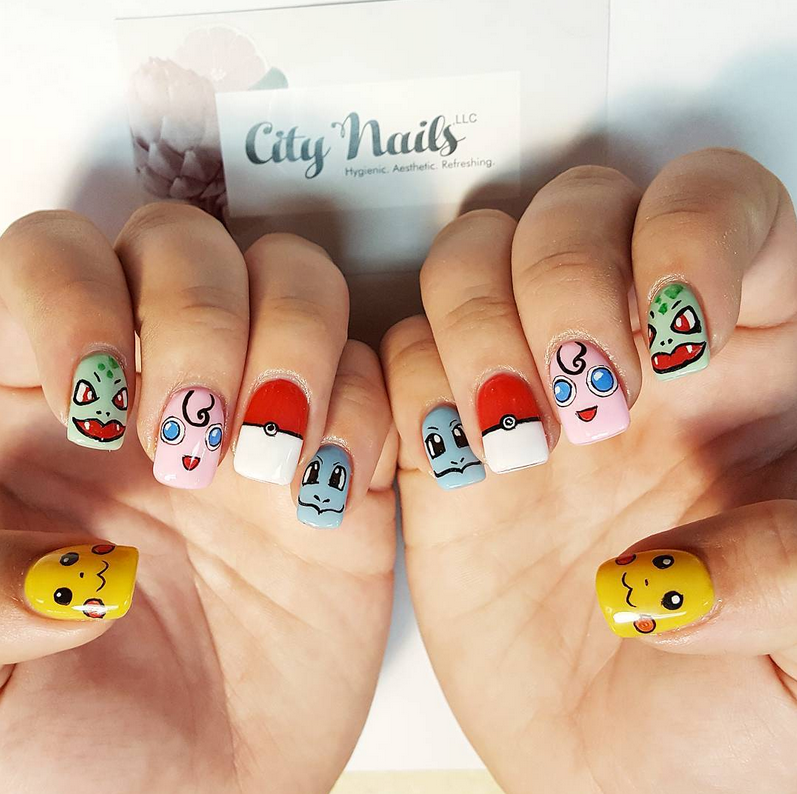 """<p>Pikachu, Bulbasaur, Jigglypuff, pok&eacute; ball, and Squirtle nails by <a href=""""https://www.instagram.com/citynailswillits"""">@citynailswillits</a></p>"""