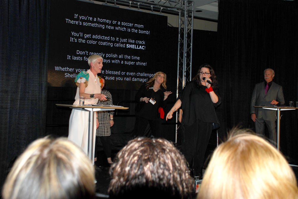 <p>Jan Arnold and the CND team perform a rap song about the rapid performance of XPress5 Top Coat, designed to expedite Shellac removal.</p>