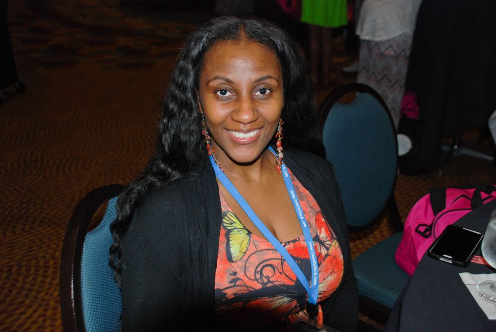 <p>Tamecia Moore getting to know fellow BeautyTech members at her table</p>