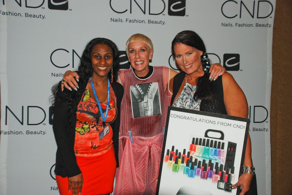<p>Tamecia Moore (left) wins a complete display of Color Wardrobe from CND</p>