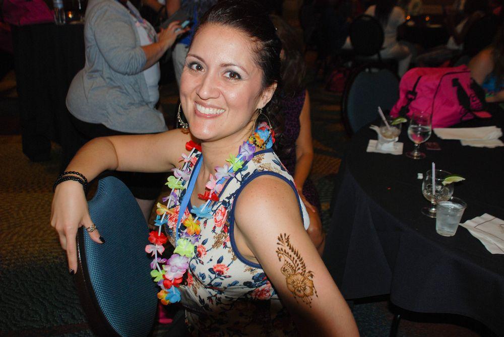 <p>Cecilia Bustamante gets henna'd by Ena Rodriguez of The Hanna Studio</p>