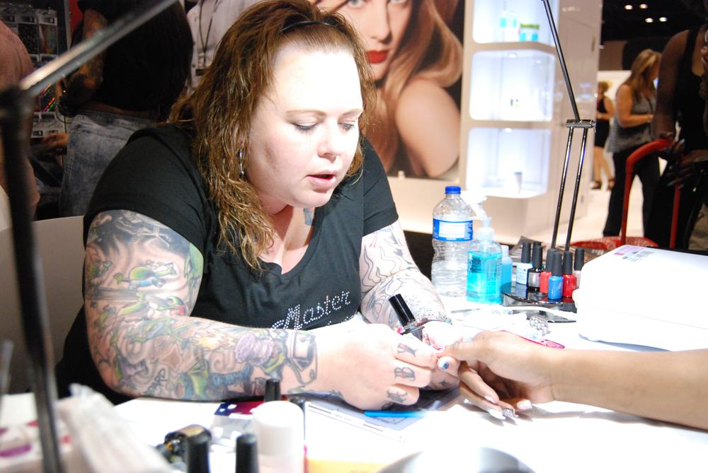 <p>January 2015 cover tech&nbsp;Amanda Lenher did demos at the Empower Nail Art booth.&nbsp;</p>