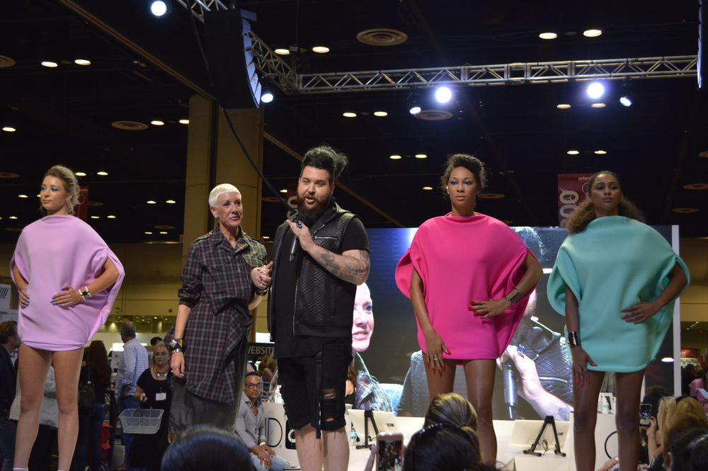 <p>Jan Arnold and Nellie Neal with models at CND's booth.</p>