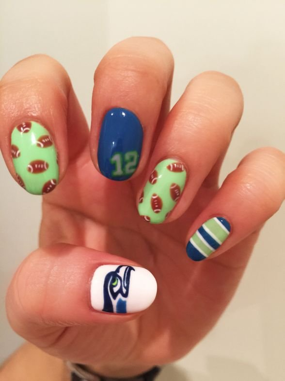 "<p>Seahawks nail art by&nbsp;Hiroko Fuijikawa. Get the step-by-step <a title=""super-bowl-nails"" href=""http://www.nailsmag.com/article/109860/nailgating-super-bowl-xlix-nail-art"" target=""_blank"">here</a>.&nbsp;</p>"