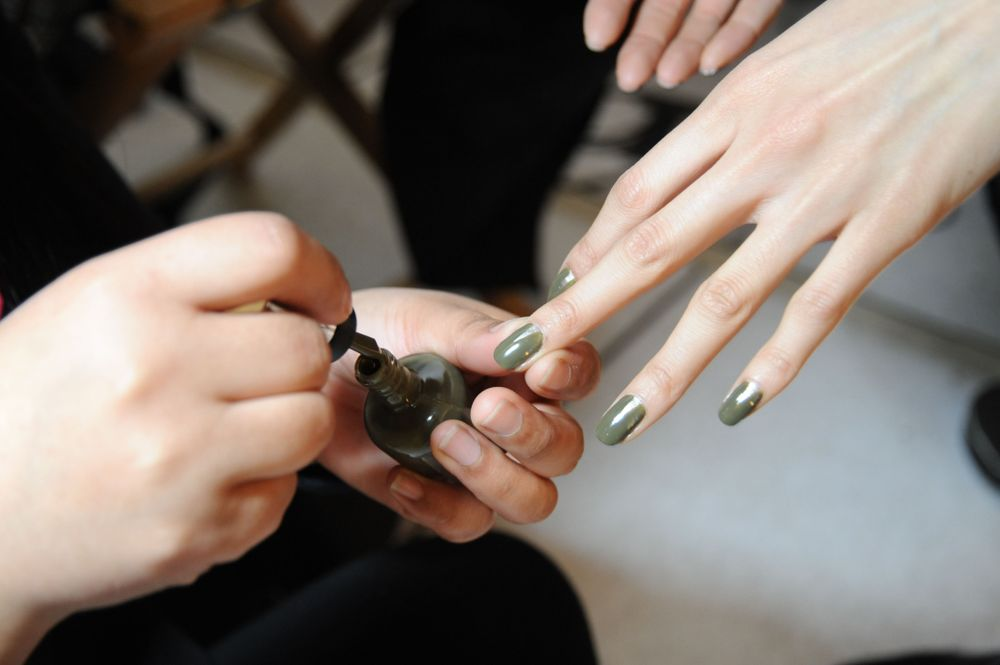 <p>BOLD COLOR: For the sixth consecutive season, Prabal Gurung collaborated with Sally Hansen to create exclusive nail polish shades to complement his Fall 2013 collection. The colors are Loden Green (shown), Night Watch (navy), and Coat of Arms (gold). Photography courtesy Sally Hansen</p>