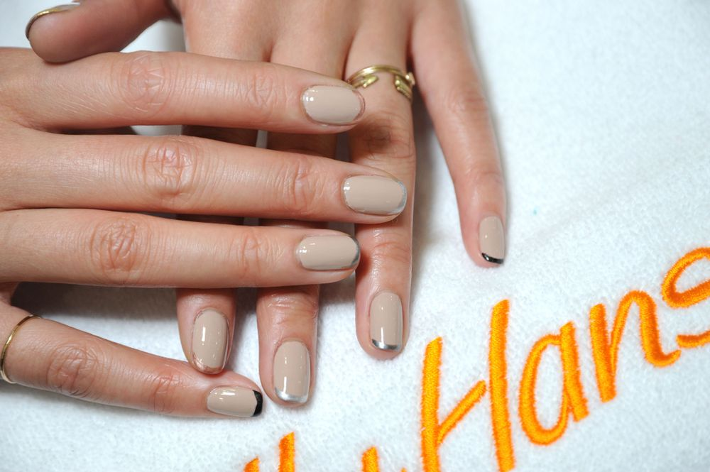 <p>NEUTRALS: On the runway, Rodarte used the Sally Hansen Complete Salon Manicure Collection to create a unique nail look for the show&mdash;a French manicure created with an edgy twist. Models walked the runway with a nude base and different colored metallic tips on each nail, creating an ombre effect. Photography courtesy Sally Hansen</p>