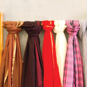Merchandise can be grouped around a single theme, like scarves. istock.com/Jannhuizenga