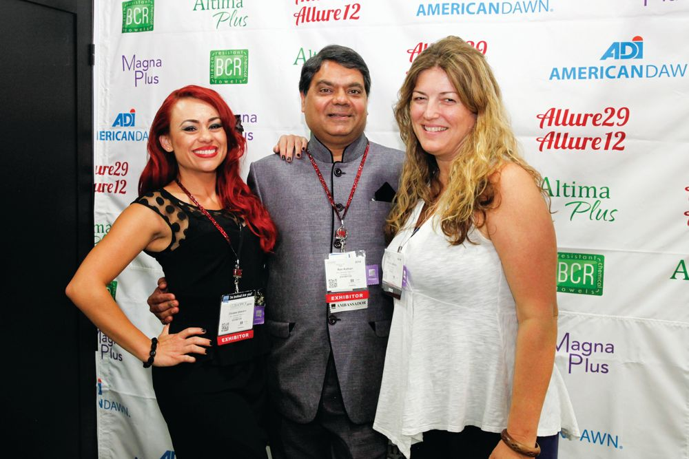 <p>Christal Zeledon, Ron Kothari, and NAILS publisher Michelle Mullen shared laughs at American Dawn&rsquo;s booth.</p>