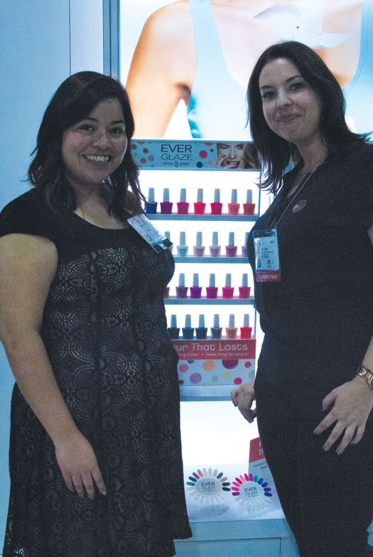 <p>Assistant editor Sigourney Nu&ntilde;ez learned about China Glaze&rsquo;s new gel/polish hybrid Ever Glaze from Tori Matt at the A.I.I. booth.</p>