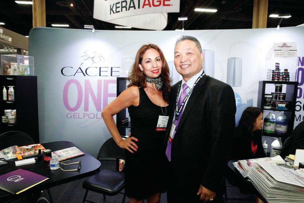 <p>Ruby Hargis and Long Truong show off Cacee&rsquo;s new booth promoting the Cacee One Gel Polish.</p>
