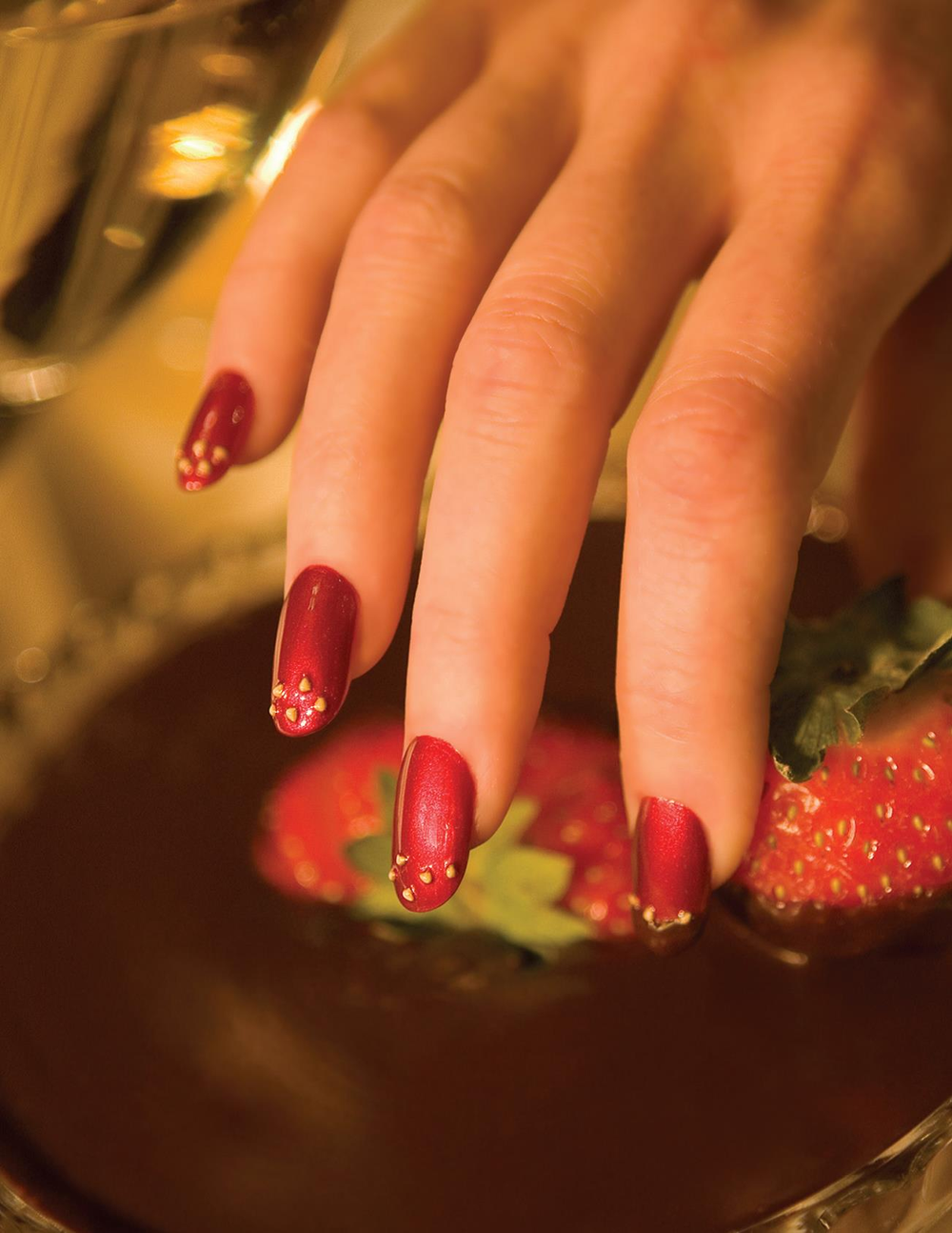 <p>Hoelscher submitted two images&nbsp;featuring her strawberry nails.&nbsp;Deciding which one belonged on&nbsp;the cover was no easy task.</p>