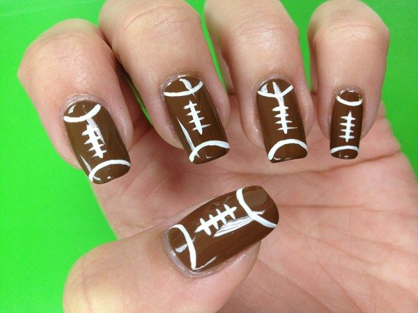 <p>Football nails by&nbsp;Natasha Karam</p>