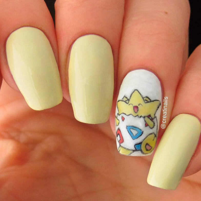 "<p>Togepi nail art by <a href=""https://www.instagram.com/creatinails/"">@creatinails</a></p>"