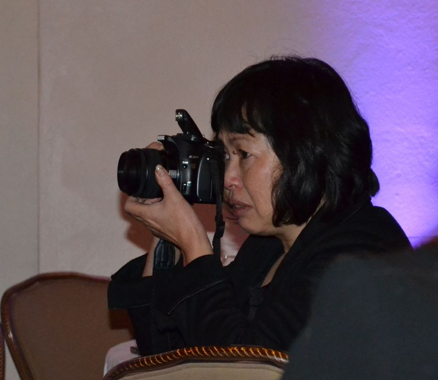 <p>A visitor from Japan, documenting the tribute with her camera, could not hide her affection or her grief at Tom's loss.</p>