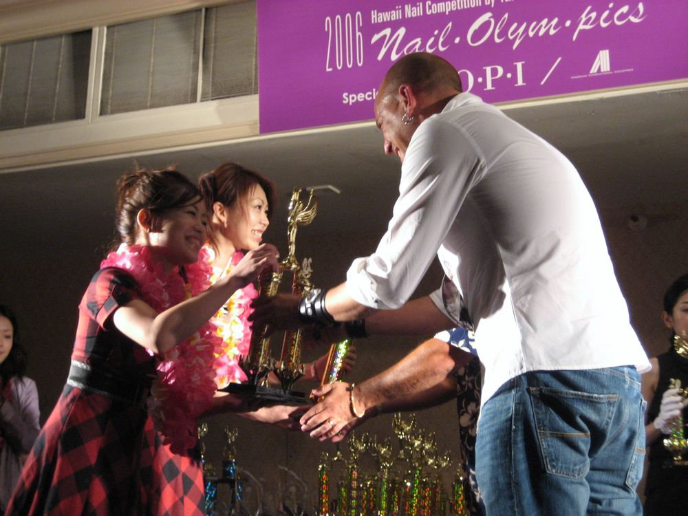 <p>Tom handing out awards at the Japan Nail Olympics in 2006 in Honolulu, Hawaii.</p>