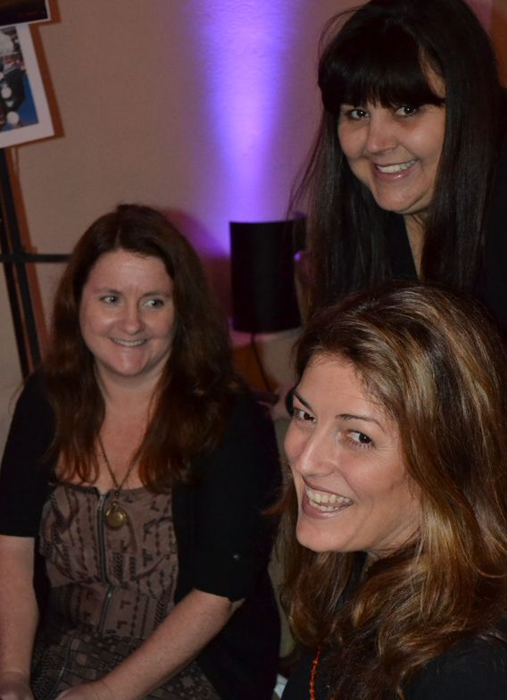 <p>(from left) Hannah Lee, Lysa Comfort, and Michelle Mullen (of NAILS) remember fun times working with Tom.</p>