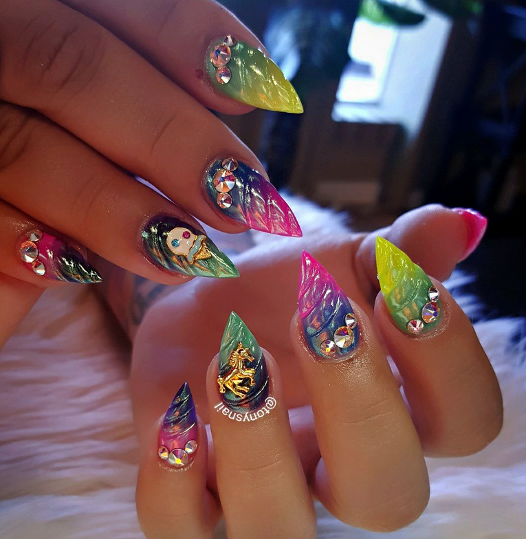 "<p><a href=""https://www.instagram.com/tonysnail"">Unicorn horn nails by Tony Ly, Wichita Falls, Texas</a></p>"
