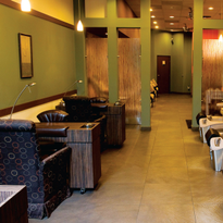 Designed by co-owner Alex Hanshaw around pressed-glass bamboo partitions, the salon mostly...