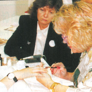 Vicki Peters demonstrates a nail technique to students at the London School of Fashion during...