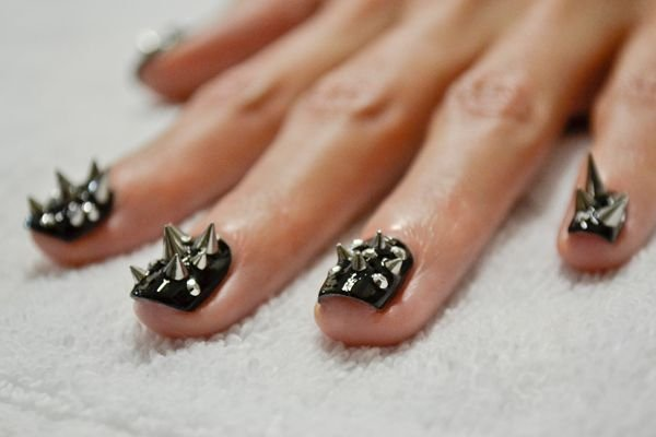 <p>4. If necessary, apply one final layer of top coat to each finger. Tip: Hold the client's hand upside down to encourage the gel to self-level and encapsulate the bottom of each spike.</p>