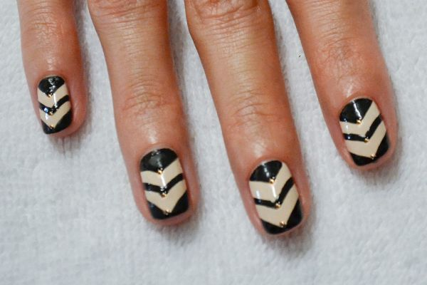 <p>4. Apply top coat and place one gold metal dot at the apex of each triangle.</p>