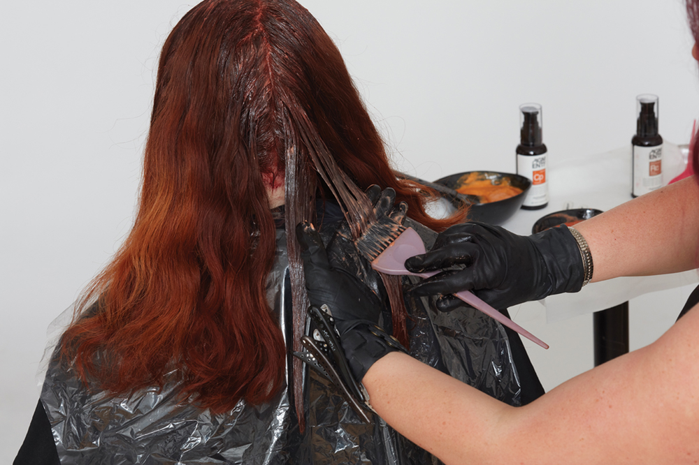 <p><strong>Step 2</strong>: While retouch formula processes, apply two shades to lengths in diagonal sections to add dimension. Alternate the two shades throughout, beginning with the lightest formula: 9.442 + 2 g rose-copper Pigments + 2 g of copper Pigments with 20-volume developer.</p>