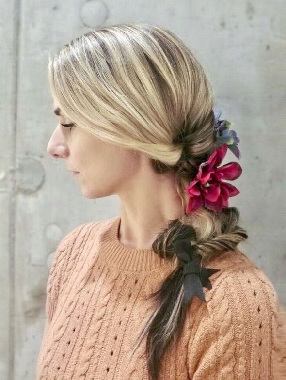 <p>Faux Flower Fall:&nbsp;The dark faux flowers were woven into two loose pigtails to create a soft undone look. The pigtails were secured at the end with a black ribbon to pull the look together. For braid beginners, the pigtails can be done easily with just a three-strand technique. You can add more dimension and texture with different braiding styles depending on your preferences and skill level.</p>