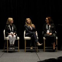 Karen Gordon onstage alongside Sheila Wilson and Amy Gibson on a panel moderated by Salon...