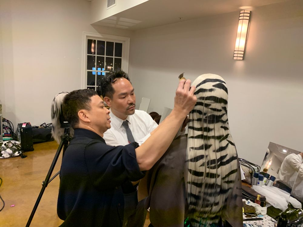 <p>Kien Hoang and Nathan Lbra prep a wig while backstage before the 2019 Oribe Atelier kicks off.</p>