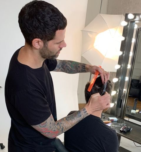 Josh DeMarco (@hairdemarco) puts the finishing touches on his client.